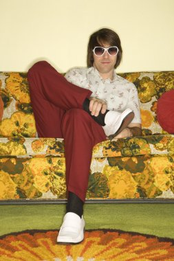 Man sitting on sofa.