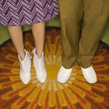 Couple's legs standing.