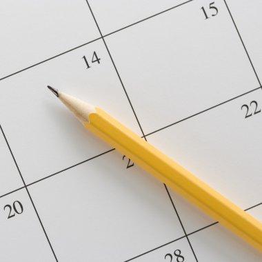 Pencil on calendar.