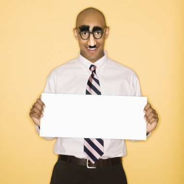 African American man wearing groucho mask disguise holding blank sign. stock vector