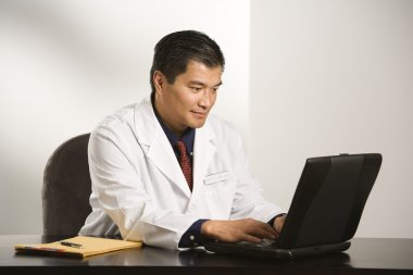 Doctor in office.