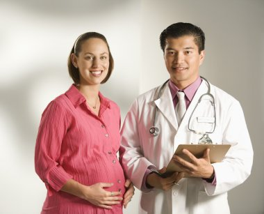 Doctor and pregnant woman.