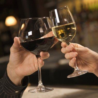Hands toasting wine.