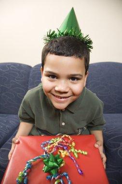 Boy with birthday present.