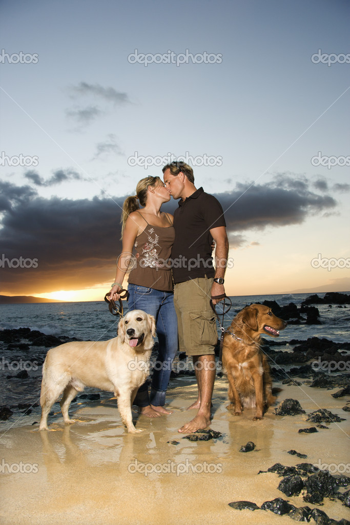 Kissing Couple With Dogs at the Beach