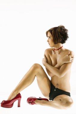 Partially nude woman.