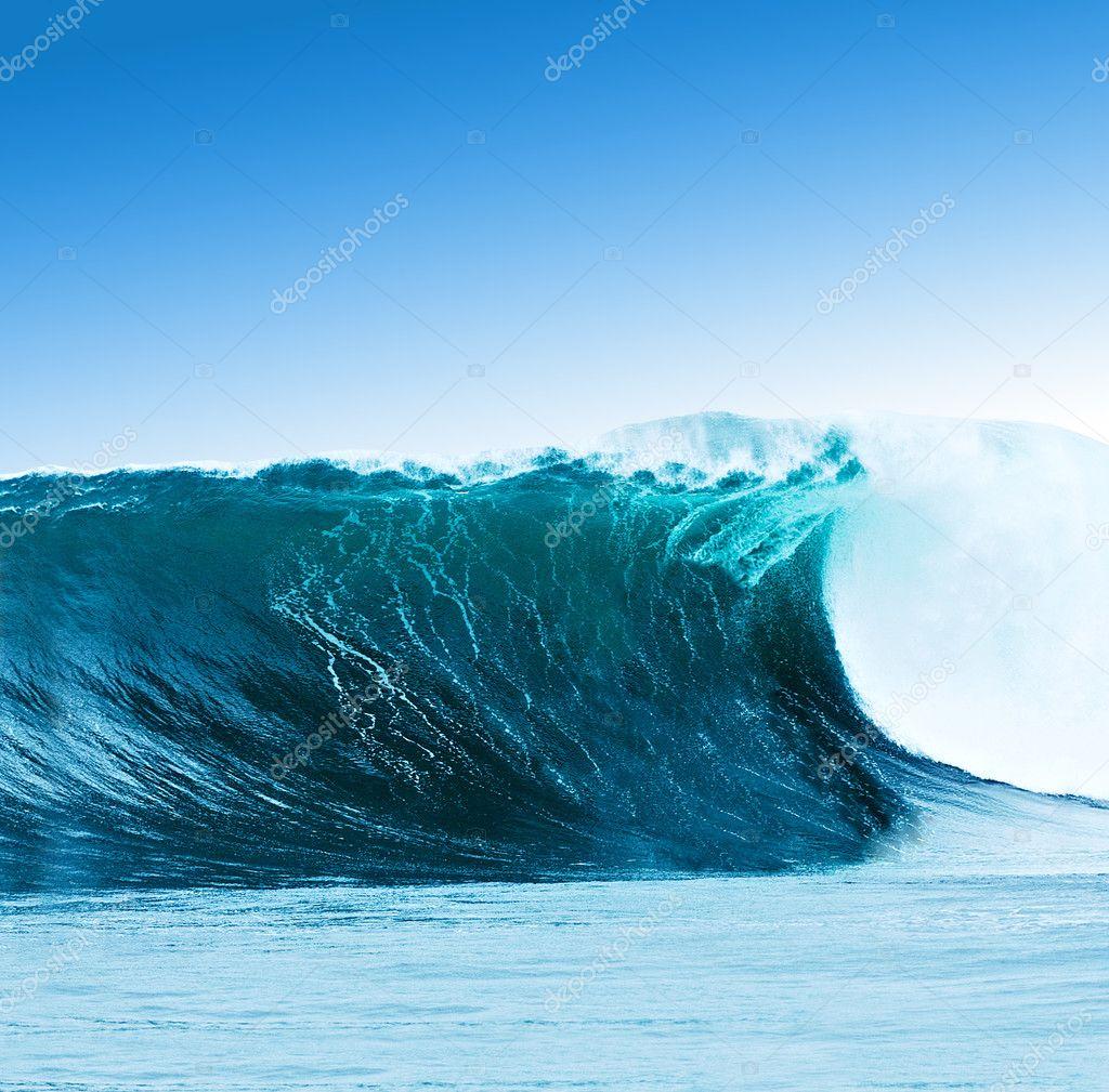 Large surfing wave breaks in the ocean
