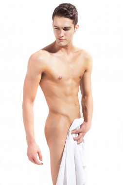 Semi naked young fitness man smiling