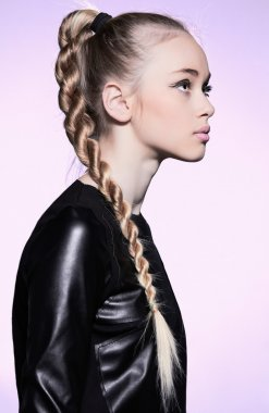 Woman with blonde hair plait in profile