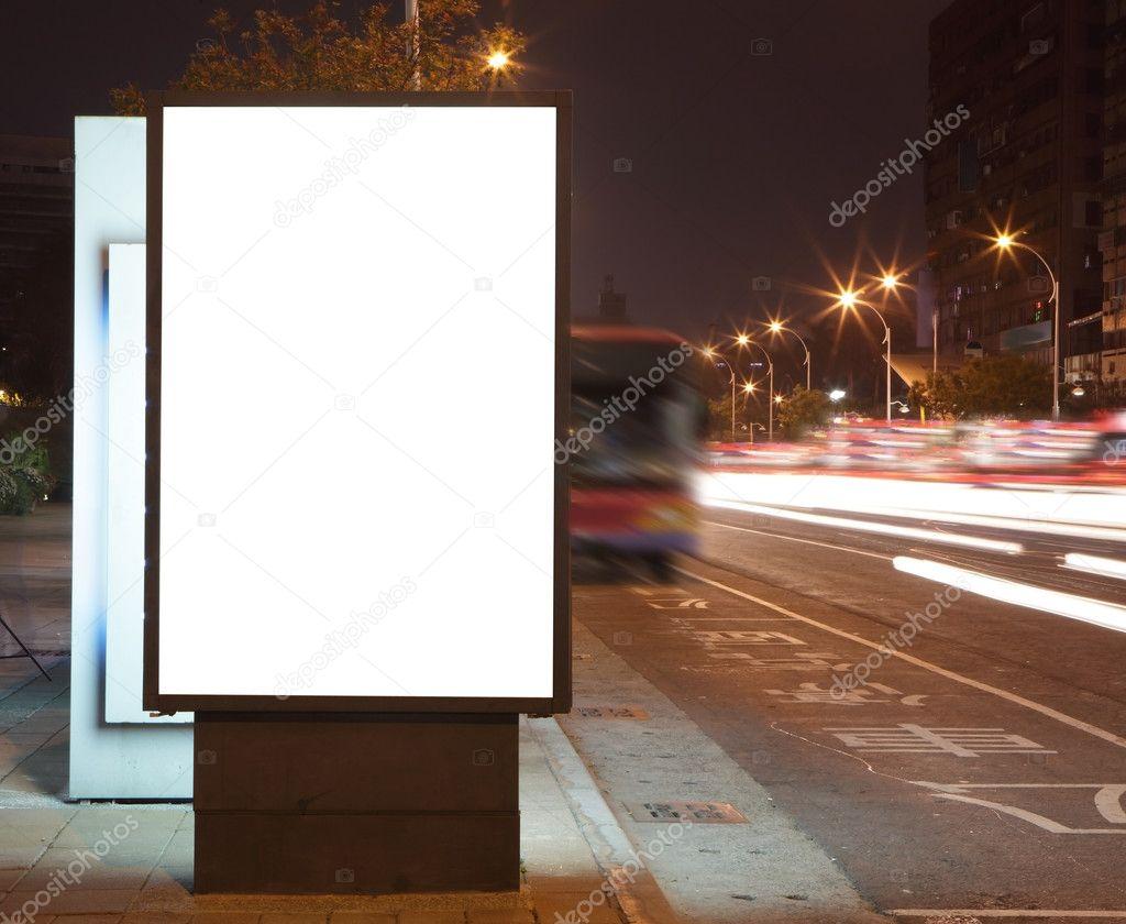 Blank billboard at night in the city Street