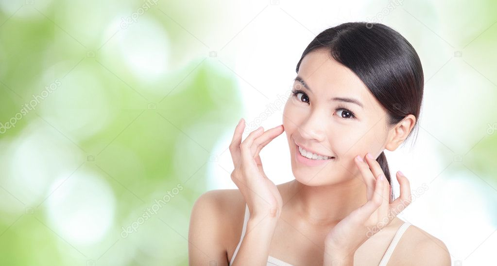 Young woman smile and hand touch face