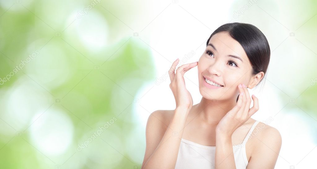 Woman smile and touch face look up forward