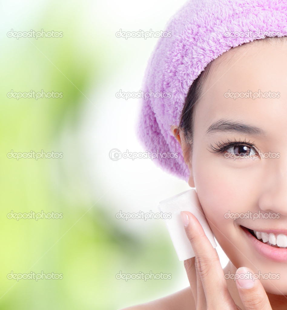 Close up of Young Girl remove makeup by Cleansing Cotton