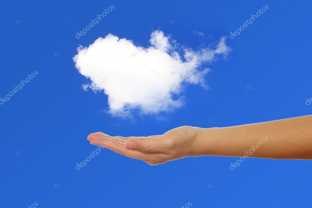 Hand holding a white cloud