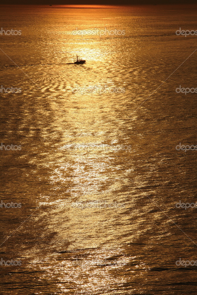 A fishing boat in golden sunset