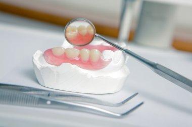 Dentist tools with acrylic denture (False teeth)
