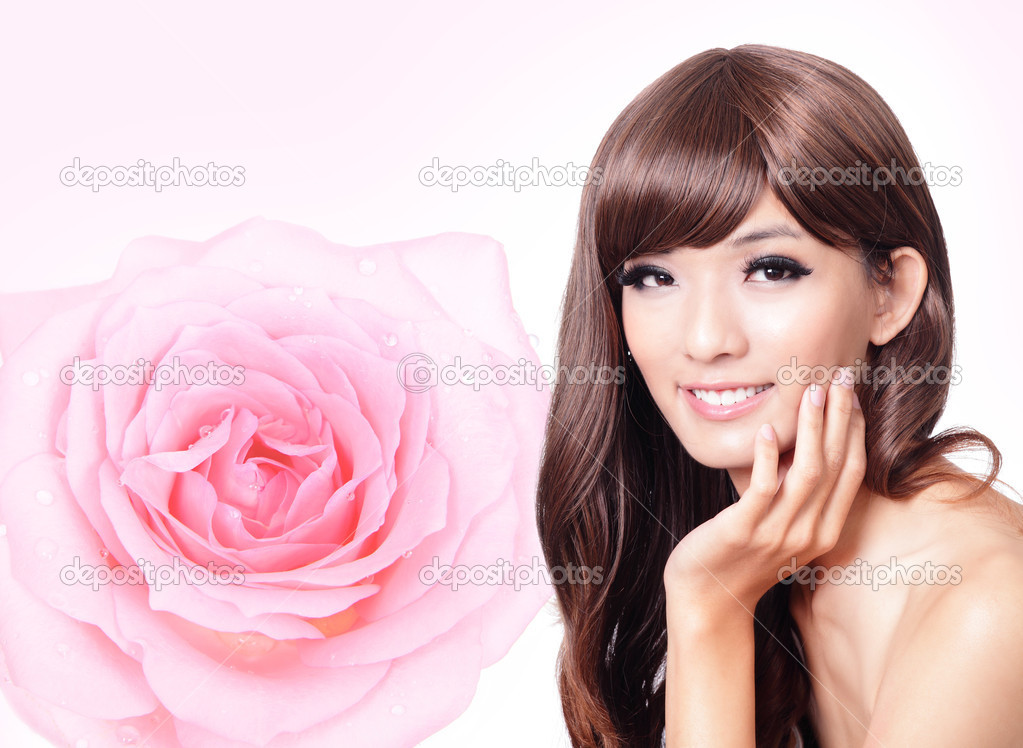Asian beauty hand touch face with pink rose