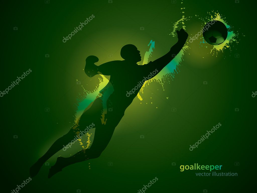 The football goalkeeper catches a ball on the dark background
