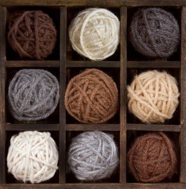 Assorted balls of yarn in a box