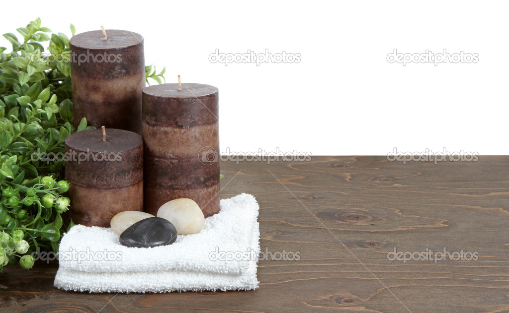 Spa still life with candles, stones and towels