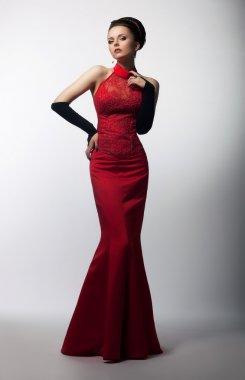 Aristocratic graceful female posing in fashion dress