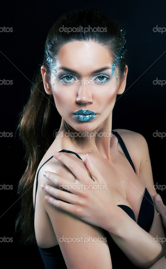 Dramatic make-up. Artistic young female portrait