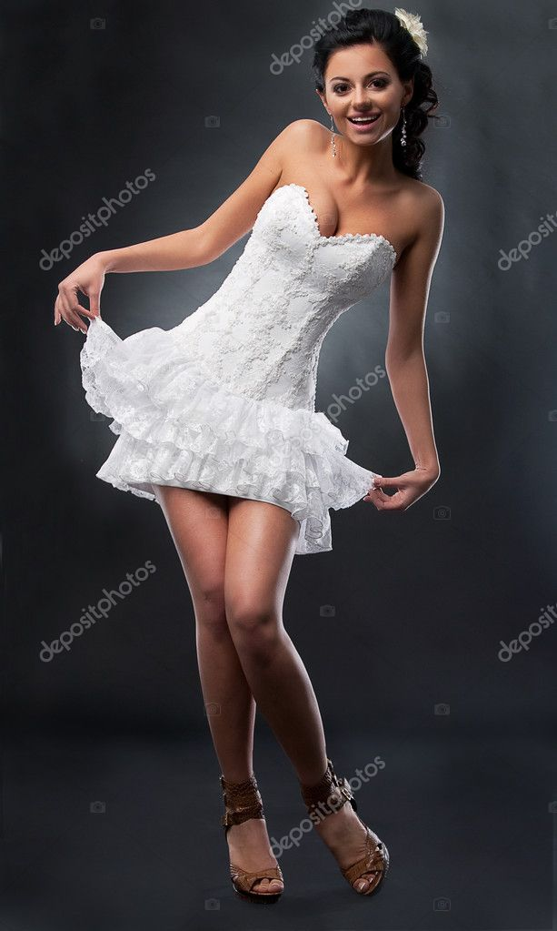 Wedding dance - happy pretty bride in short bridal dress dancing