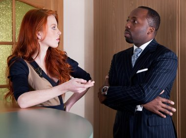 Business team - red head freckled pretty lady and black man