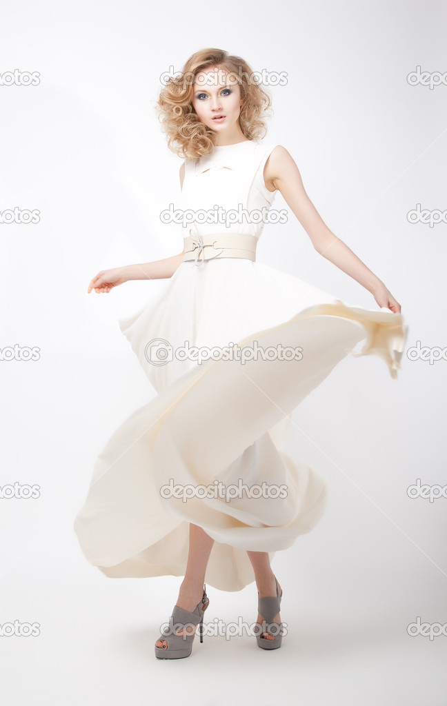 Lifestyle - fashionable young female in light flying dress