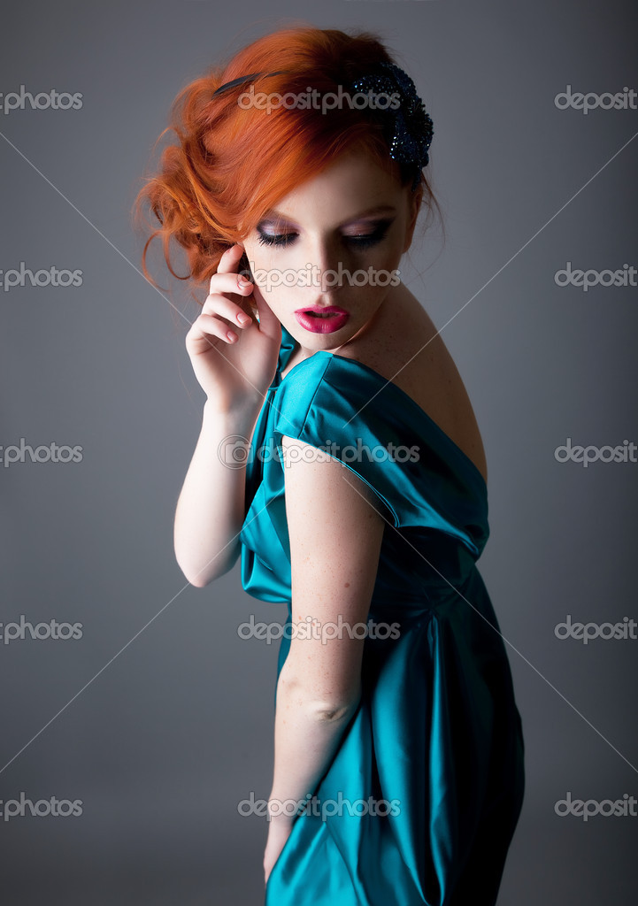 Portrait of lovely red head sexy girl with freckles
