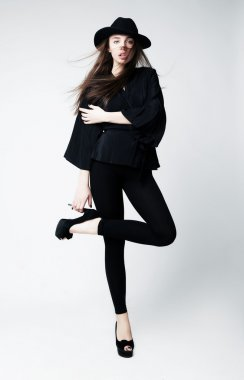 Vintage - stylish caucasian girl in black clothes isolated