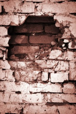 Hole in wooden board , grunge brick