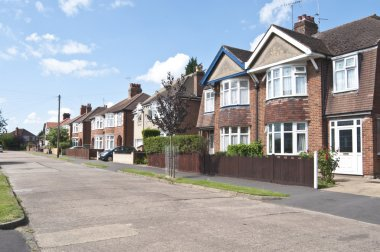 Street of semi detached & detached houses in urban area