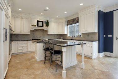 Upscale kitchen with granite island