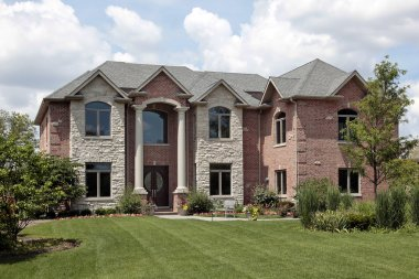 Brick home with white columns