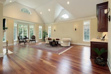 Family room with curved windows