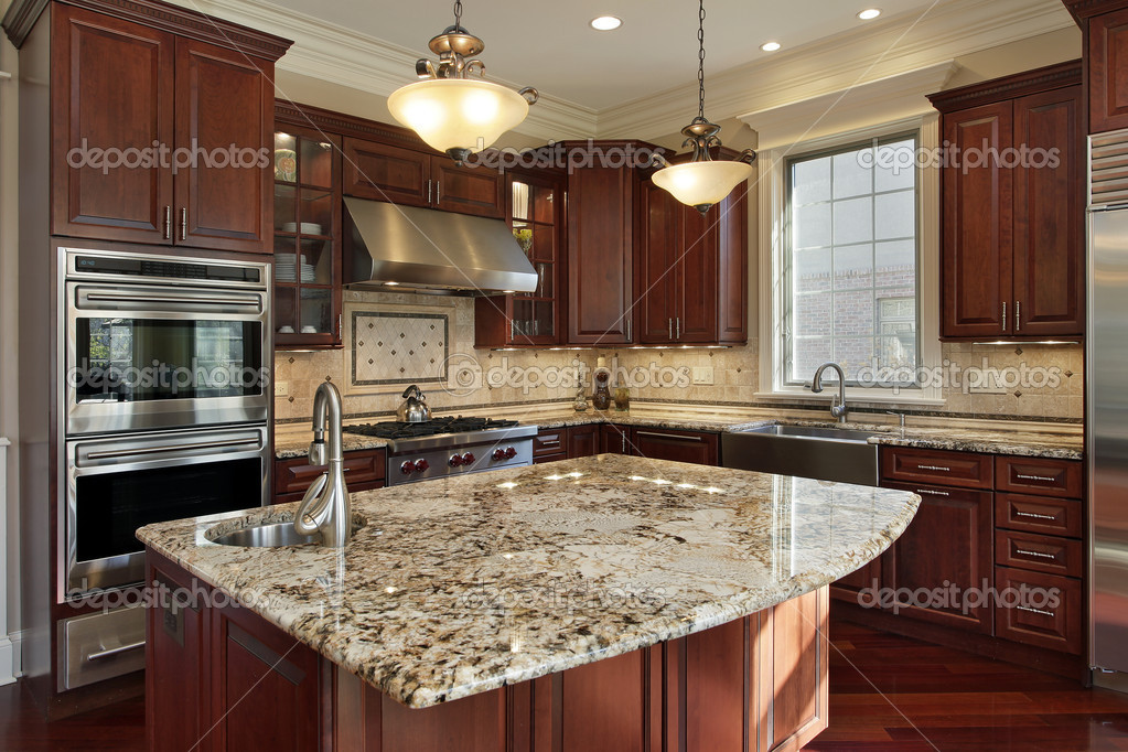 Kitchen with granite island and cherry wood cabinetry stock vector
