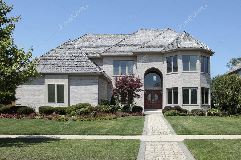 Suburban home with arched entry