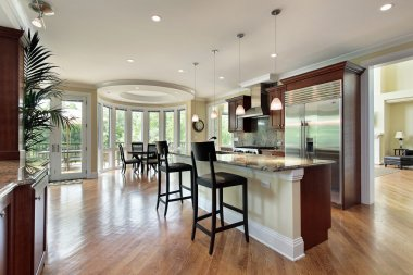 Kitchen with curved eating area