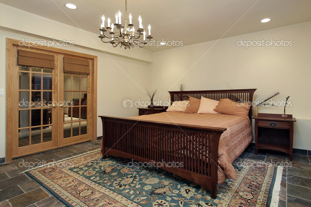 Guest bedroom with french doors — Stock Photo © lmphot #8679064