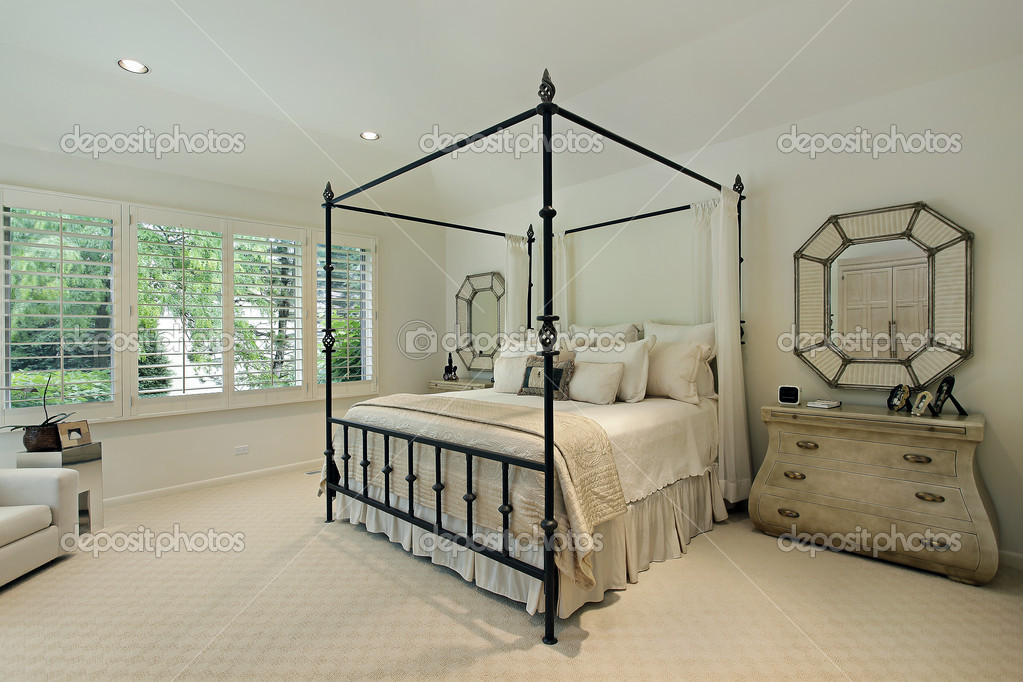 Master bedroom with tray ceiling — Stock Photo © lmphot #8679219
