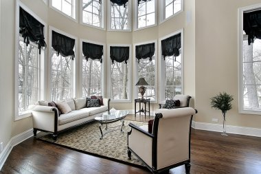 Living room with curved windows