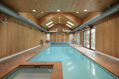 Indoor swimming pool with wood siding