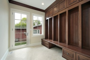 Mud room with wood cabinet