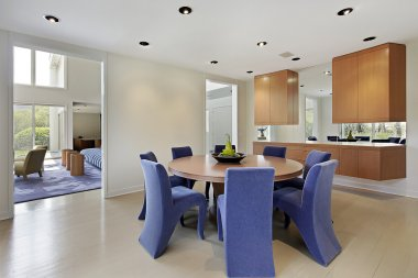 Dining room with lavendar colored chairs
