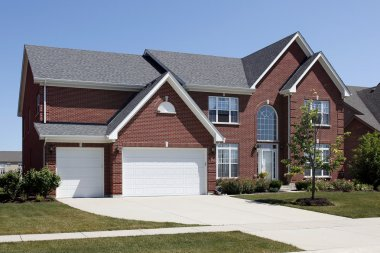 Red brick home with three car garage