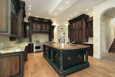 Kitchen with dark cabinet