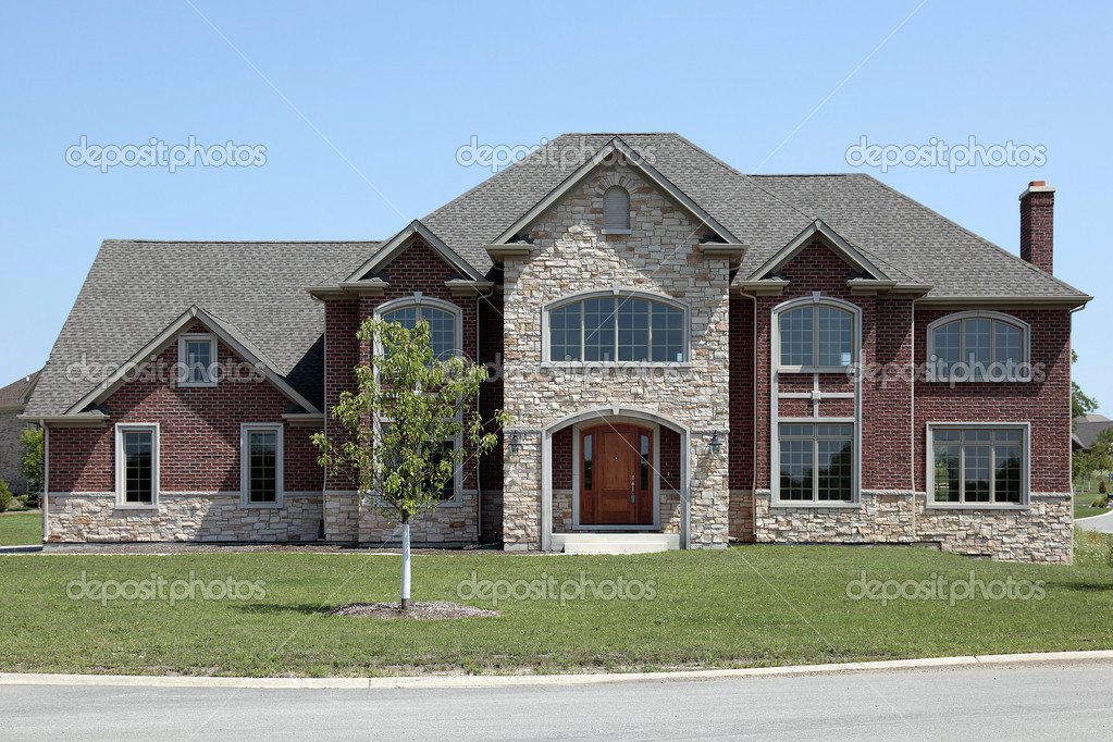 New construction brick and stone home stock photo for Brick home construction