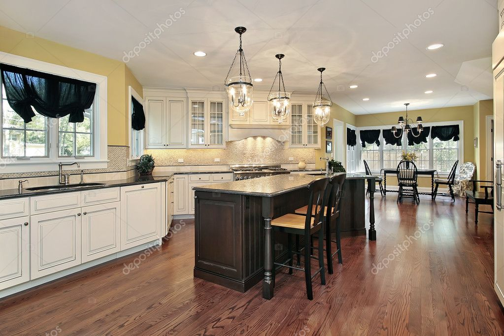 Kitchen with island and eating area — Stock Photo © lmphot #8694581