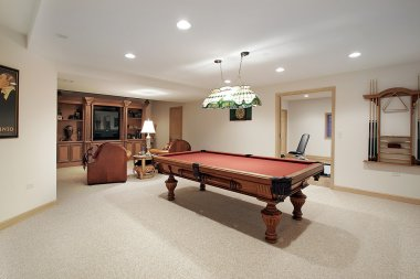 Basement pool table and stained glass light